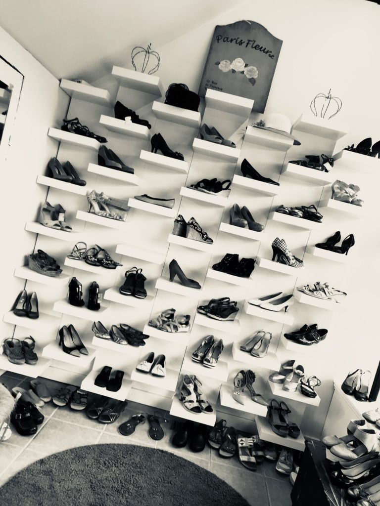 Shelves of Shoes for days at Thrifty Princess Boutique