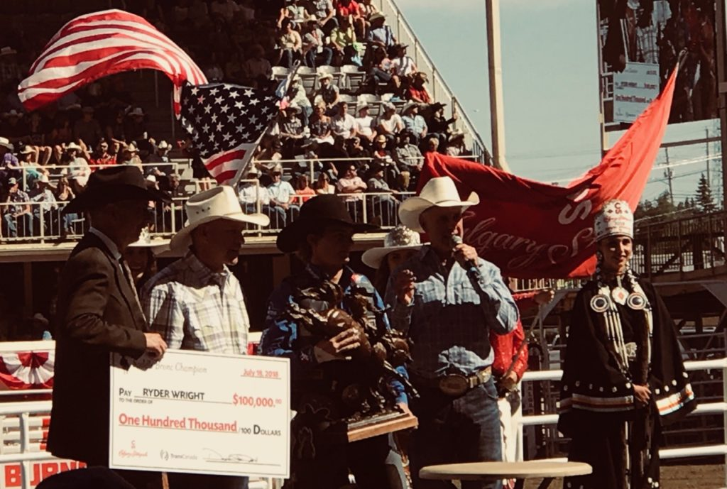 Giving out prizes at the Rodeo, during the Calgary Stampede.